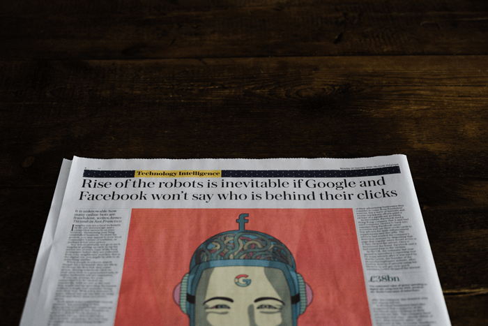 Newspaper headline on Google and Facebook