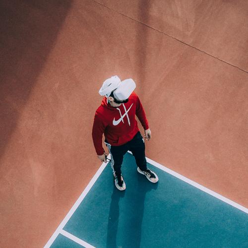 Man wearing VR headset on basketball court