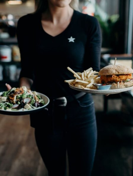 Server bringing food to a table