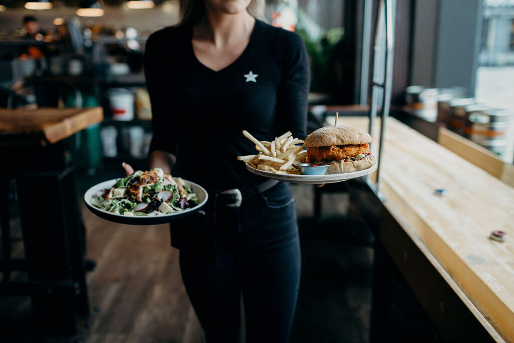 Server delivering food to a table