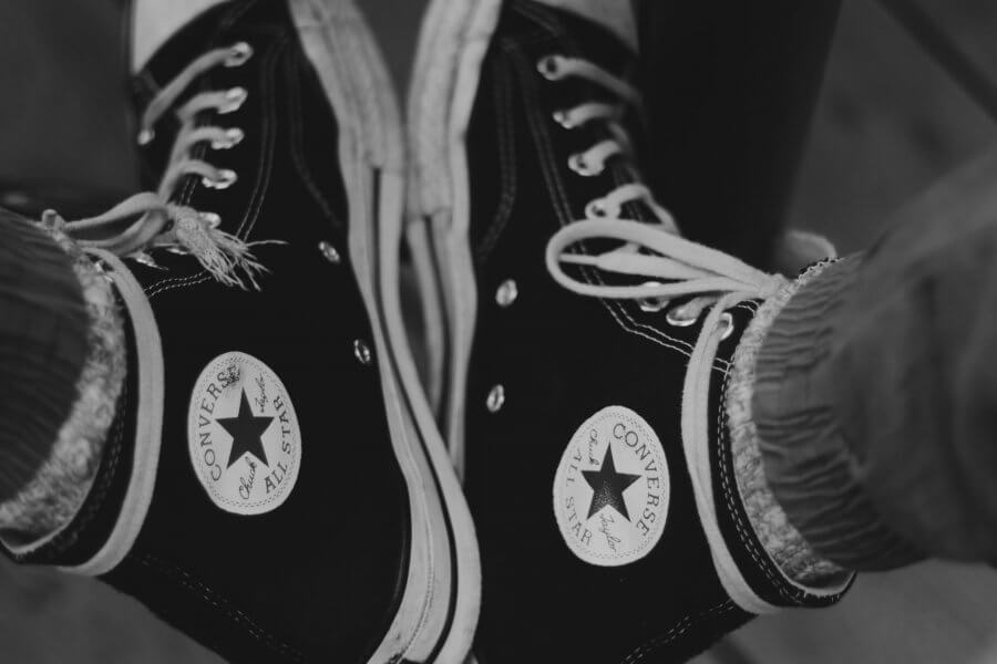 a pair of chuck taylors / converse shoes.
