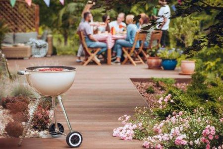 Friends enjoying a backyard patio in the summer