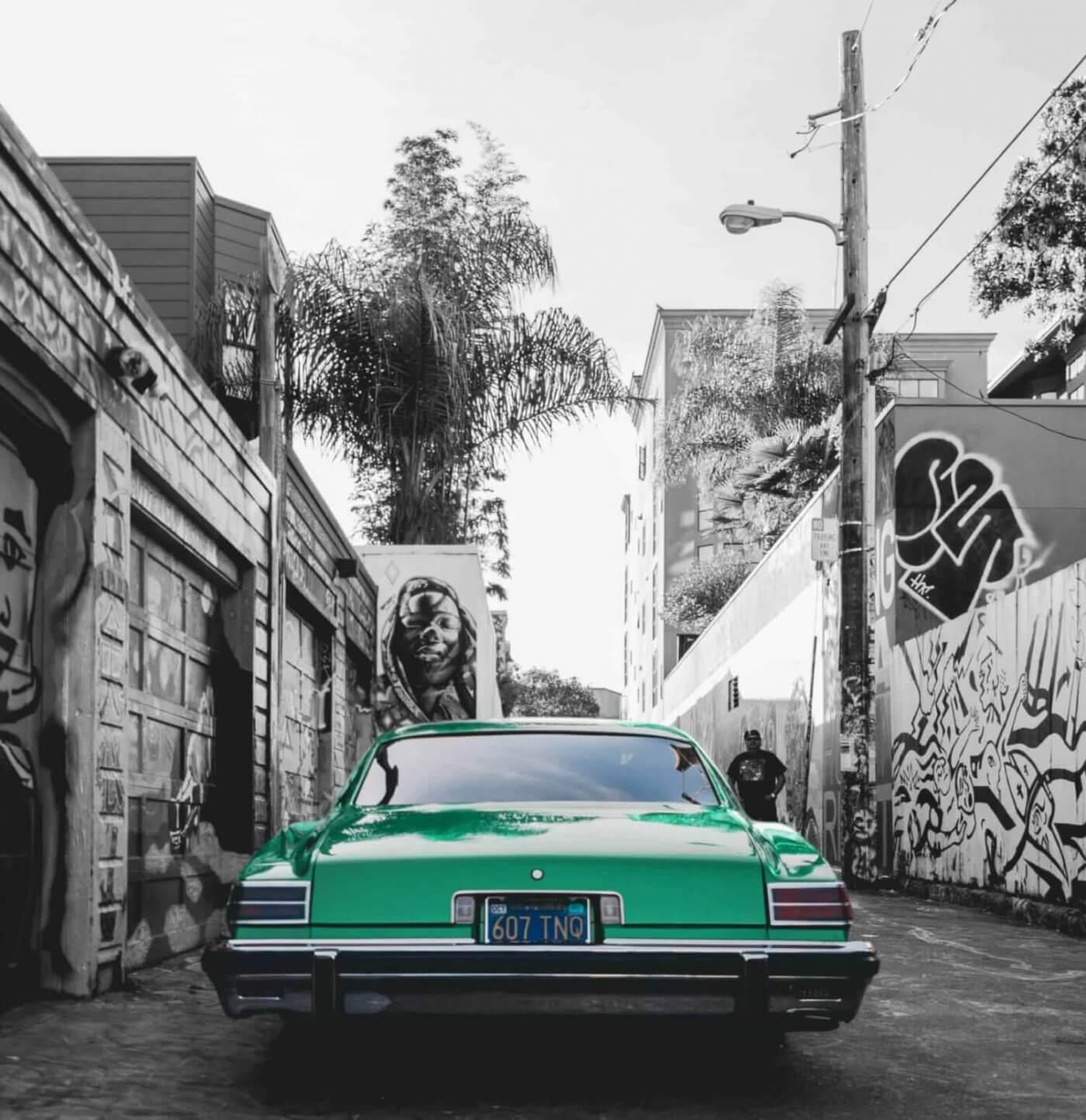 Green car in alley
