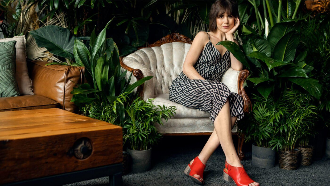 model wearing ketch shoes on chair