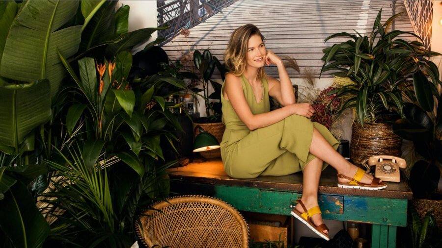 woman wearing ketch shoes on desk