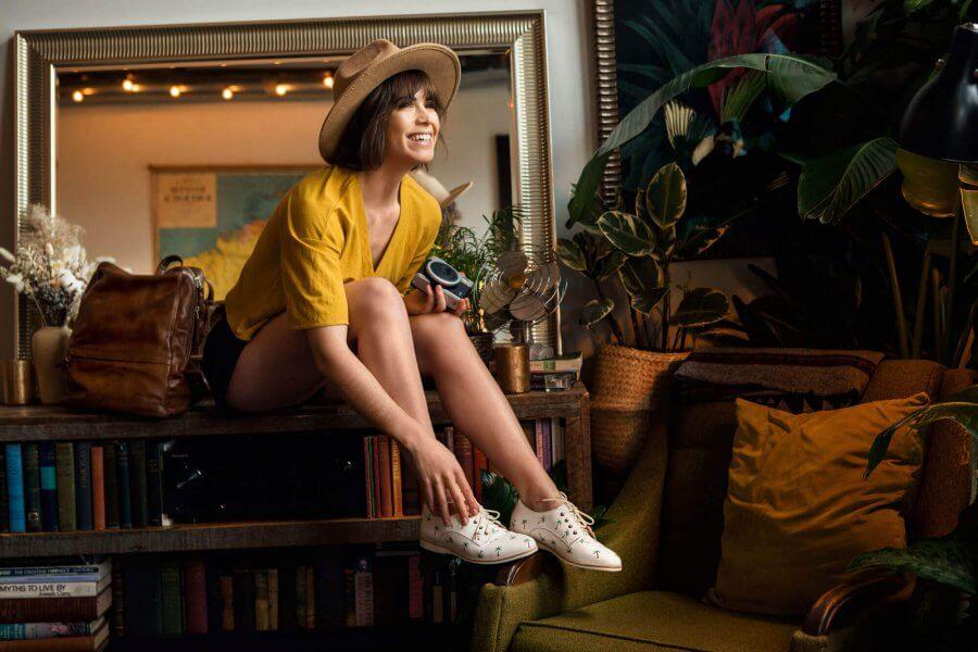 Woman sitting on desk wearing ketch shoes