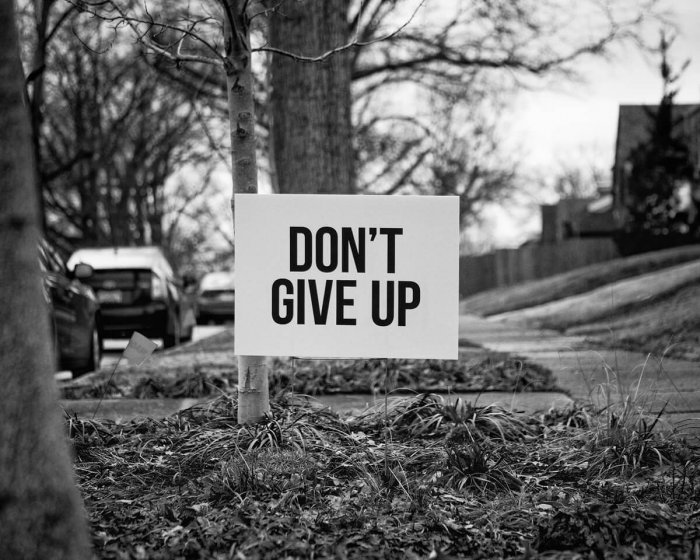 "A sign that reads ""don't give up"""